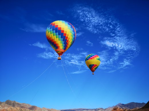 TWO HOT AIR BALLOONS andy-wong-1347662-unsplash